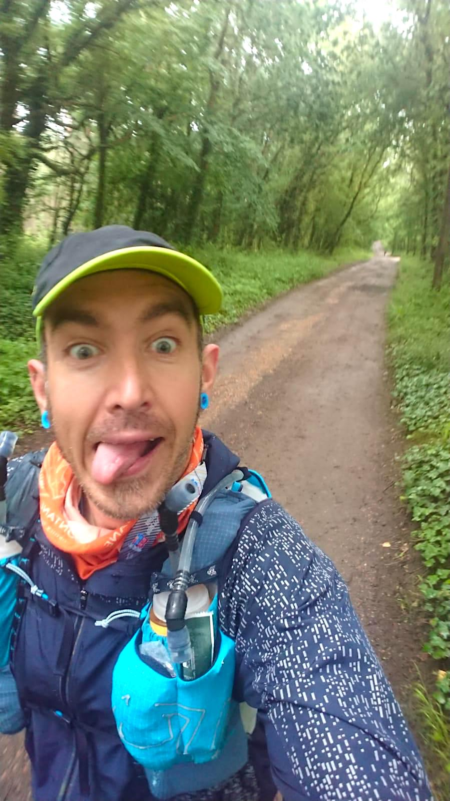 Trust volunteer sticks out in tongue for a selfie during the 2021 Isle of Wight Challenge ultra marathon