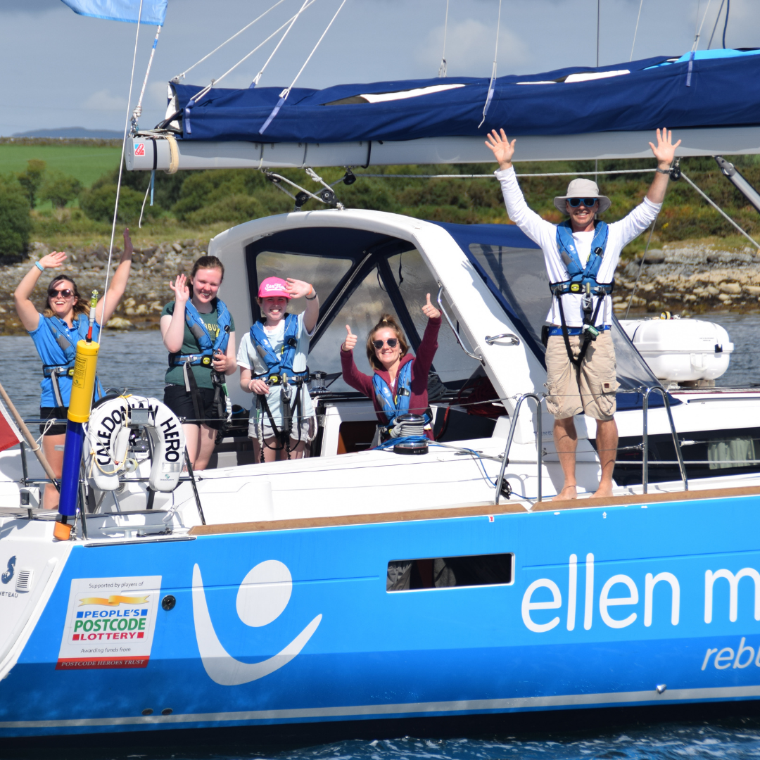 Ellen MacArthur Cancer Trust sailing boat in Largs with young people cheering to thnak People's Postcode Lottery for their support