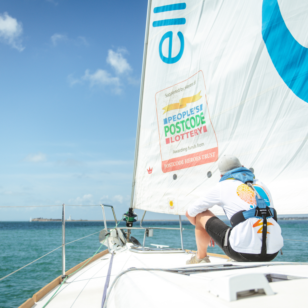 Ellen MacArthur Cancer Trust sailing boat with People's Postcode Lottery branding