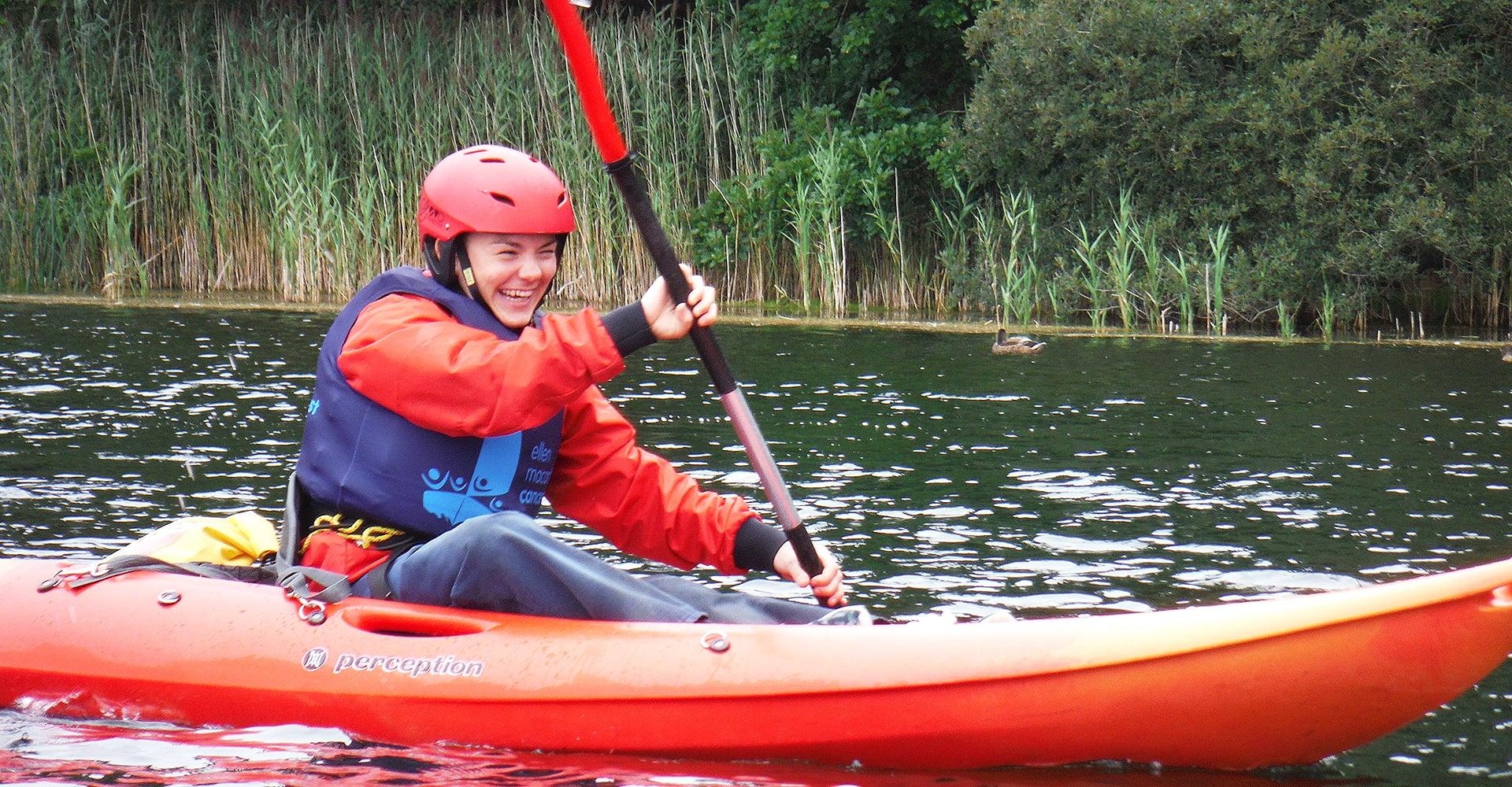 Rosa paddling in a kayak