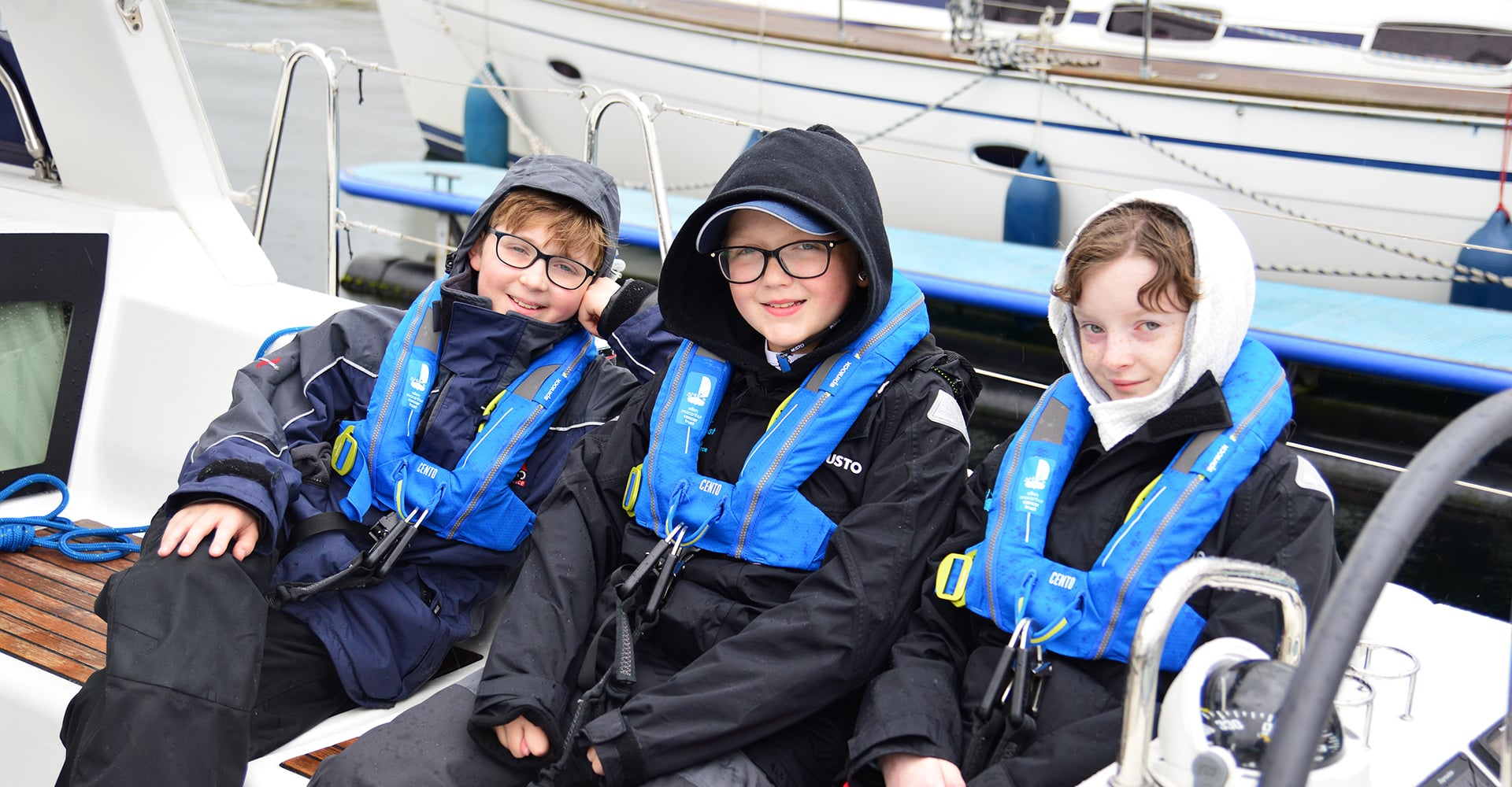 Finn relaxing on the yacht with two of his crew mates