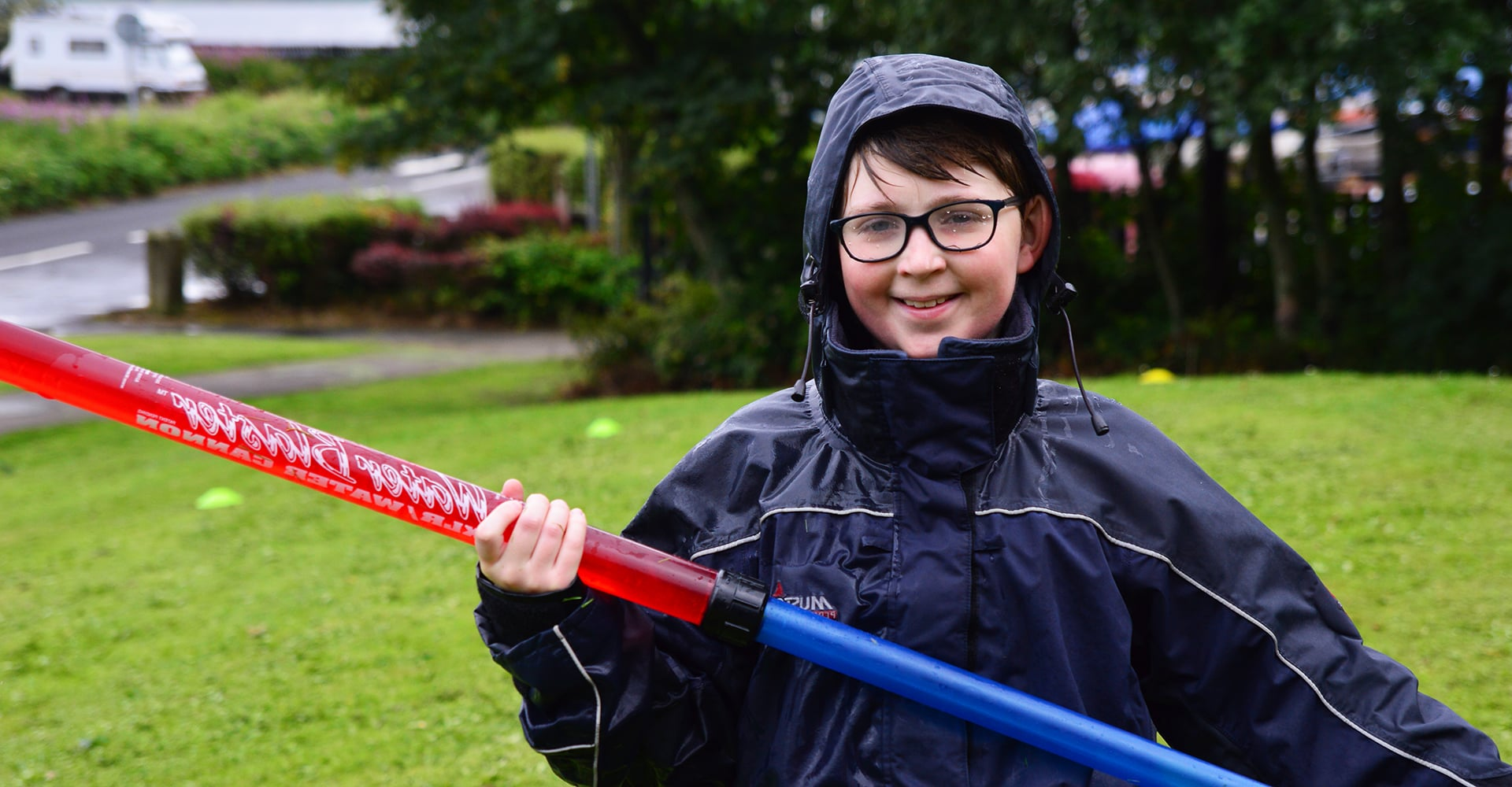 Finn holding a large water gun on a trip in Largs