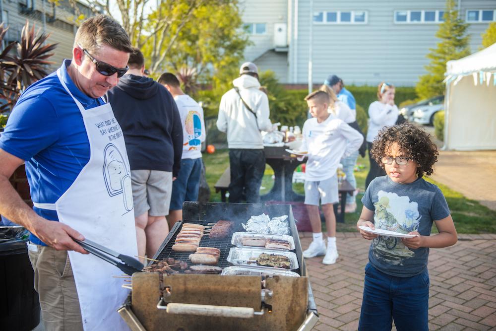 Frank Fletcher, Ellen MacArthur Cancer Trust CEO, serving at the BBQ at East Cowes Marine