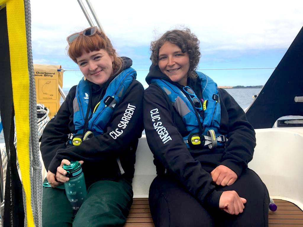 Laura Rohdich (l) and Sarah Matthews (r) from Young Lives vs Cancer on a yacht on a Taste of the Trust day in Northern Ireland