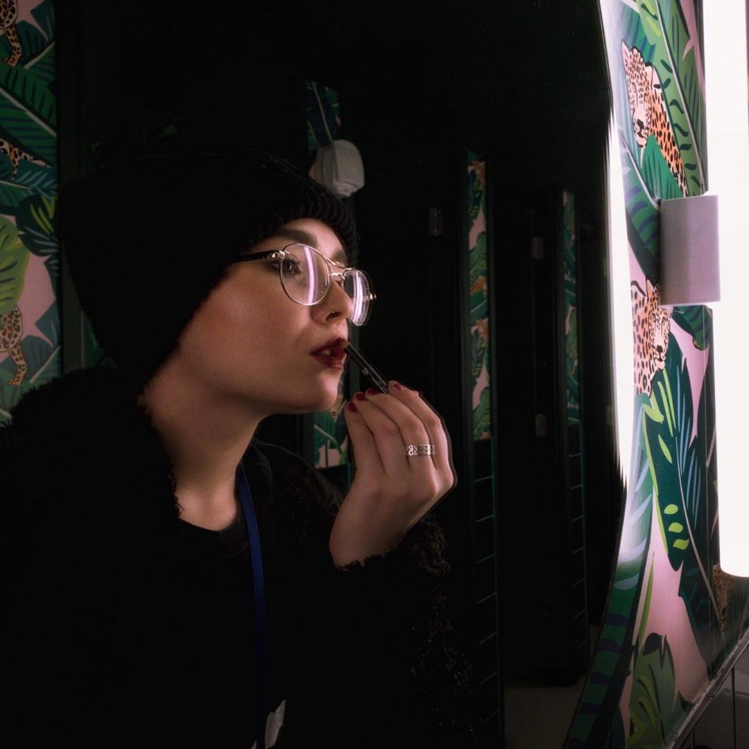 J-whitehead applying makeup at work