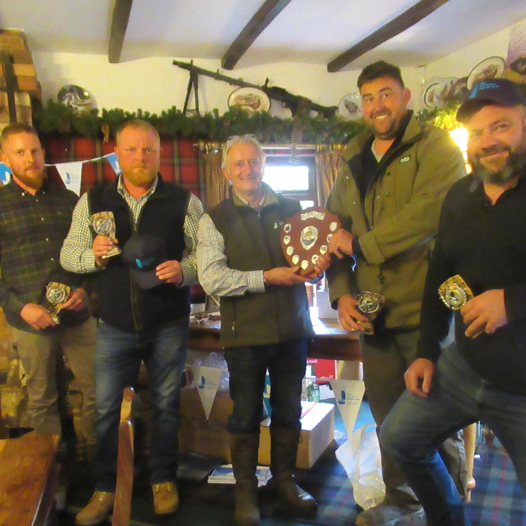 John Burton awarding the winning team the Simon R Burton trophy