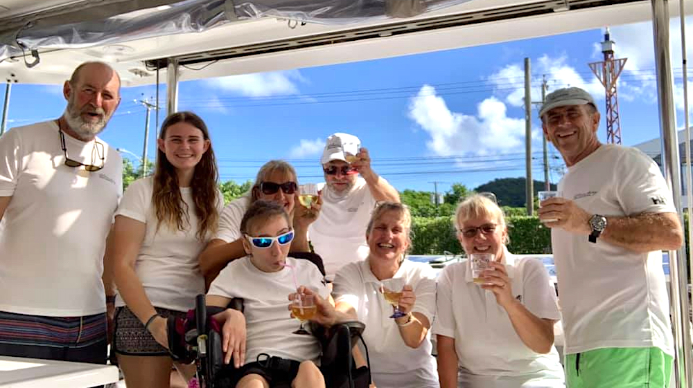 Natasha Lambert and her family and crew toast their arrival in St Lucia