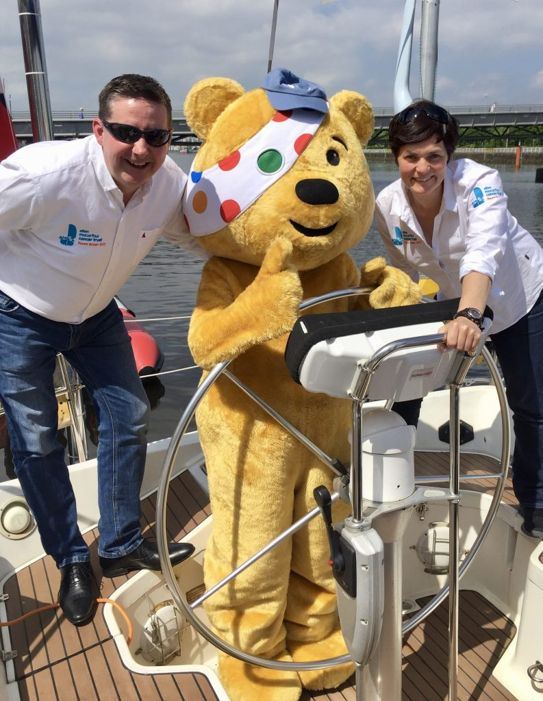 Ellen MacArthur and Frank Fletcher showing Pudsey bear how to sail