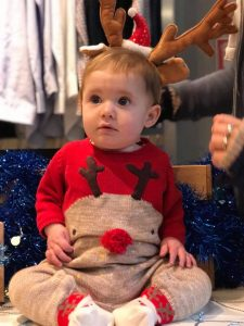 Baby girl dressed as a reindeer at the Jingle Bell Walk