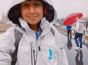 Claire pictured outside of the houses of parliament proudly wearing her Ellen MacArthur Cancer Trust jacket