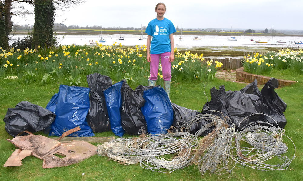Ella Eastwood with all the rubbish she collected