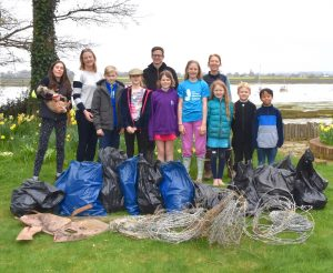 Ella Eastwood with her family after the shore clean up