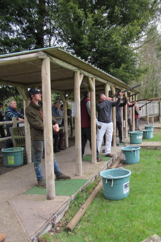 Competitors firing their guns on the clay shoot range at the 2019 John Burton annual clay shoot day