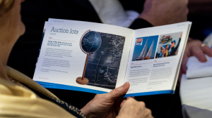 A picture of the auction booklet from the Ellen MacArthur Cancer Trust BT Tower charity gala dinner