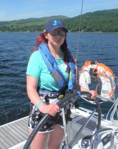 Katie Holland on the helm of her first Trust trip in Largs last summer