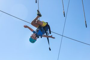 Young person on the high ropes during Ellen MacArthur Cancer Trust trip