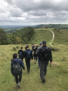 Teekay hikers crossing the South Downs